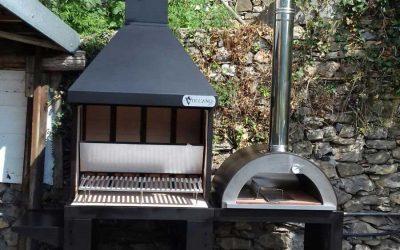 Barbecue con forno a legna